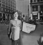 selling-newspaper-on-street
